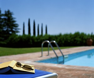 Book and sunglasses on sun lounger (focus on book and sunglasses)